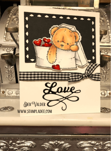 Love Bear in an envelope with Valentine hearts.
