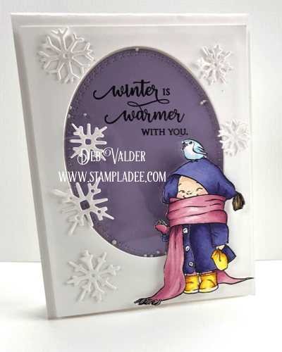 Bundles little person feeding a bird on a snowy day in a shaker card