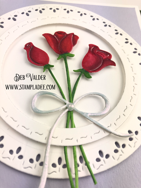 Red Roses are paired with Stitched square and circles for a beautiful card