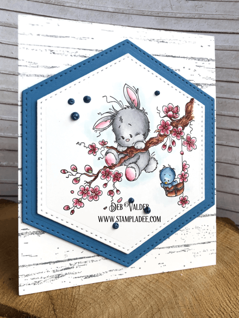 Some Bunny needs to hang on, I love this little whimsical stamp.